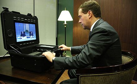Russian President Dmitry Medvedev attending the Singapore APEC summit, holding a videoconference with Rashid Nurgaliyev via a Tactical MXP, after an arms depot explosion in Russia (2009). Medvedev and Nurgaliev TANDBERG Tactical MXP.jpg