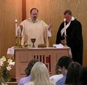 A United Methodist Elder presides at the Eucharist, assisted by a Deacon.