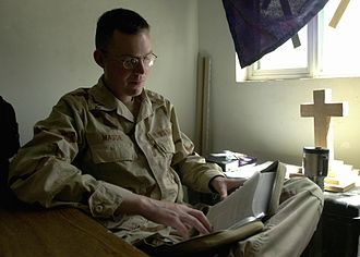 Chaplain - A U.S. Navy chaplain in Iraq studies his Bible for an upcoming service.