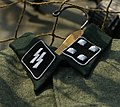 Military equipment replicas for WW2 re-enactment in Fort Harrison State Park, Lawrence, Indiana, US September 2008. German Waffen SS uniform tunic SS runes Collar tabs rank insignia patches hanger etc.jpg