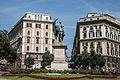 Monumento a Vittorio Emanuele II e al centro di piazza Corvetto (Genova).jpg