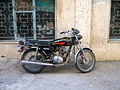Motorcycle near wall parked - alley in Shariati st - Nishapur.JPG