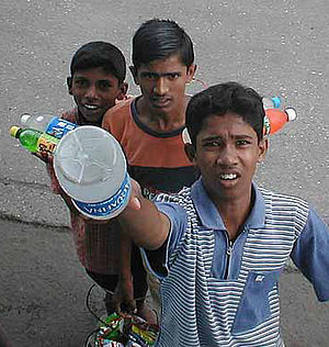 Street children in India - Street children in Mumbai, India selling snacks and drinks to bus passengers