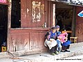 Naxi ladies in an old village near Lijiang - panoramio.jpg