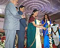 Nirmala Sitharaman lighting the lamp at the Centenary Celebrations of Women's Christian College, in Chennai. The Vice Chancellor, University of Madras, Prof. R. Thandavan and the Principal, Women's Christian College.jpg
