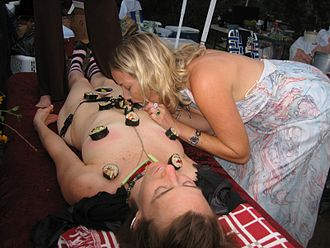 Nyotaimori - Guest eating sushi directly from a model's body at Burning Flipside event, USA, 2007