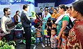 Official of the Agriculture Department explaining regarding agricultural product to the villagers at the Exhibition Stalls put up by the various departments of Government of India, State Government.jpg