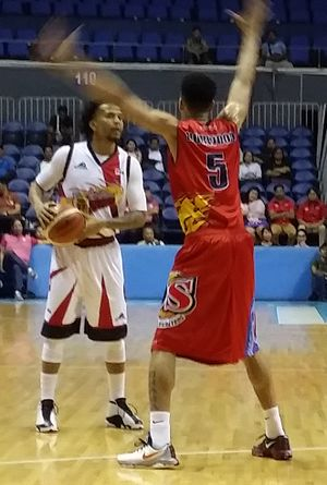 Chris Ross (basketball) - Ross (left) being guarded by Gabe Norwood