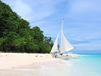 Paraw - A paraw sailboat on a beach