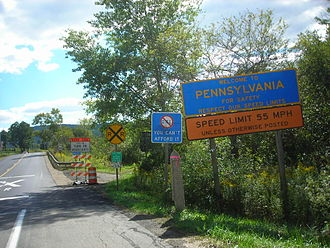 Pennsylvania Route 446 - PA 446 beginning at the state line with a plethora of signage denoting the switch from NY 305