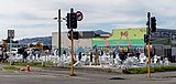 """People painting the monument """"185 Empty Chairs"""", Christchurch, New Zealand.jpg"""