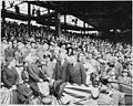 Photograph of President Truman throwing out the first ball at the opening game of the baseball season, at Griffith... - NARA - 200202.jpg