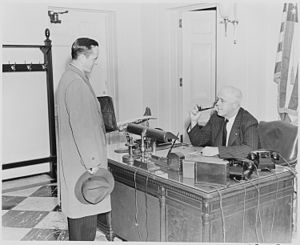 Receptionist - White House receptionist William Simmons at his desk in 1946, conversing with a visitor