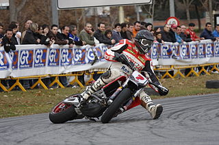 Supermoto Motorcycle racing on a circuit that alternates between track, motocross and road racing