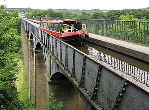 A canal boat traverses the longest and highest...