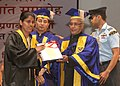 Pranab Mukherjee awards a student, at the 26th Convocation of Indira Gandhi National Open University (IGNOU), in New Delhi. The Minister of State for Human Resource Development, Shri Jitin Prasada is also seen.jpg