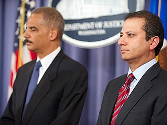 Preet Bharara - Bharara (right) waits with Attorney General Eric Holder to announce charges related to the 2011 alleged Iran assassination plot