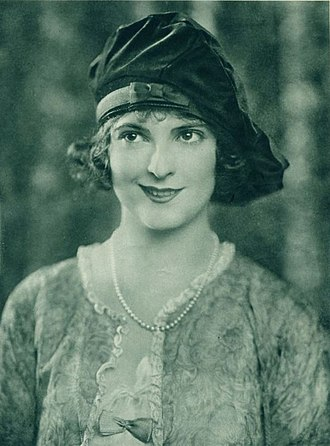 Tam (women's hat) - Priscilla Dean wearing a tam with side draping