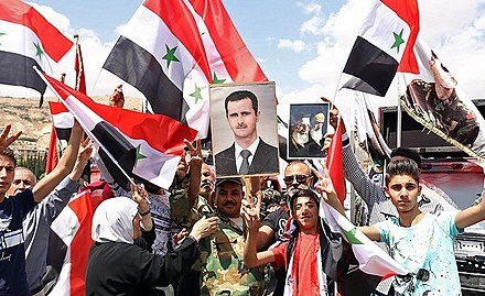Pro-government Syrians with portraits of Assad, Ayatollah Khomeini and Khamenei, April 2018 Pro-government Syrians demonstration in Damascus after US missile strike 06.jpg