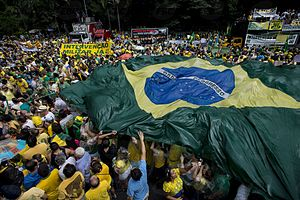 2015–16 protests in Brazil - Protesters in São Paulo with a large Brazilian flag.