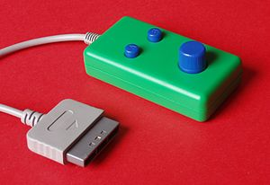 Paddle (game controller) - A paddle controller for the Sony PlayStation.