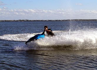 Jetboat - A rider on a Yamaha Waverunner XL performing a high-speed turn.