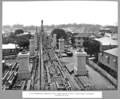 Queensland State Archives 3710 South approach looking north from Wilson street fabricated steelwork stacked on site Brisbane 20 October 1936.png