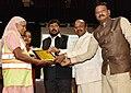 Ramdas Athawale along with the Chairman, National Commission for Safai Karamcharis (NCSK), Shri Manhar Valjibhai Zala distributing the Safety Kits to Safai Karamcharis.JPG