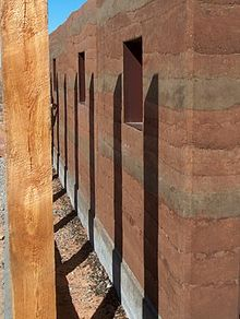 Rammed earth wikipedia for Adobe house construction cost