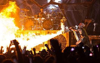 """Till Lindemann - Till Lindemann with a flamethrower during a concert performance of """"Mein Teil"""""""