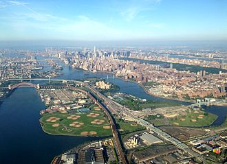 Randalls and Wards Islands - Looking southwest; Randalls Island is in the foreground and Wards Island is behind it. Roosevelt Island and Manhattan can be seen in the background.