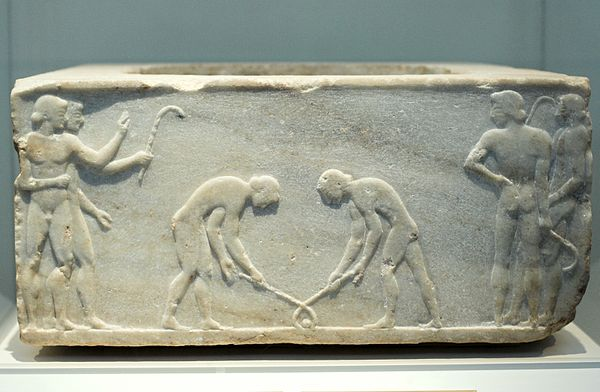 "Relief of 510 BC depicting ancient Greek players of keretizein, an ancestral form of hockey or ground billiards; in the National Archaeological Museum, Athens Relief pentelic marble ""Ball Players"" 510-500 BC, NAMA 3476 102587.jpg"