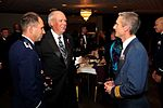 Retired Gen Lance W Lord and Col John Shaw speak with Wg Cdr David Keighley.jpg