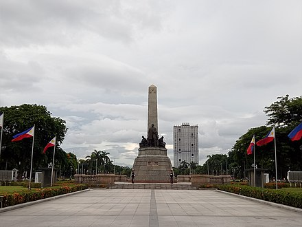 View of the Rizal Monument in Rizal Park with the controversial Torre de Manila looming in the background. Rizal Park Front View.jpg