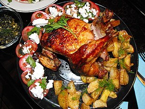 English: Oven roasted chicken with potatoes. Б...