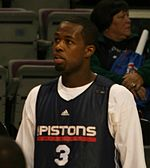 A basketball player wearing a black jersey with the word «PISTONS» and the number 3 on the frontRodney