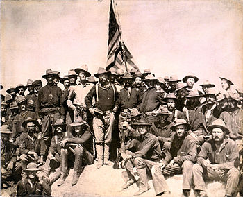 Theodore Roosevelt and his Rough Riders on top of San Juan Hill