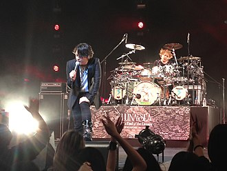 Shinya Yamada - Shinya (right) performing with Luna Sea  in Singapore 2013