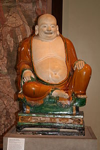 A glazed stoneware statue of Budai, Ming Dynasty, China, dated to the 20th year of the Chenghua Emperor, or 1468 AD