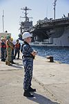 Sailors stand by as the aircraft carrier USS Harry S. Truman (CVN 75) arrives at Naval Support Activity Souda Bay 160621-N-IL474-290.jpg