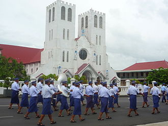 Music of Samoa - Samoa police brass band marching in Apia to flag raising ceremony. The band marches every morning Mondays - Fridays in Samoa.