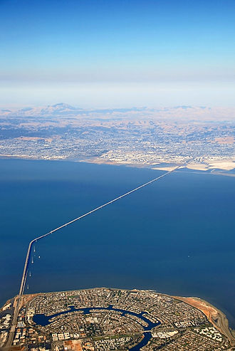 Hayward, California - Aerial view of San Mateo-Hayward Bridge. Foster City in foreground, Hayward across San Francisco Bay, Mount Diablo in background (left)