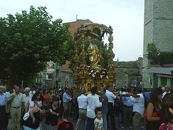 A statue of St. Rosalia being carried through ...