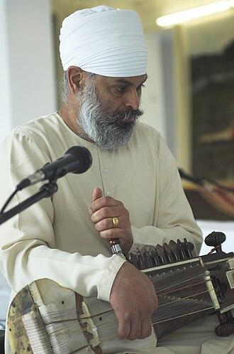 Sarangi - Surjeet Singh tuning his Sarangi