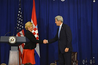 Kolinda Grabar-Kitarović - President Grabar-Kitarović with the US Secretary of State John Kerry at the Equal Futures Partnership meeting, 2016