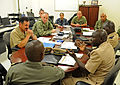 Senegalese Navy Chief Petty Officer Badjie Mamadou, right, speaks with U.S. Navy Master Chief Marco Ramirez, the command master chief of U.S. 6th Fleet, during a noncommissioned officers course as part of Africa 120807-N-AQ172-015.jpg