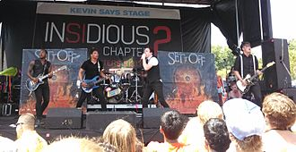 Set It Off (band) - The band performing in 2013 at Warped Tour