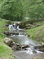 Small water cascade by roadside near Fairbourne Mill - geograph.org.uk - 410059.jpg