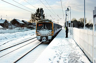 Winter of 2009–10 in Great Britain and Ireland - A train pulling into Watlington railway station, 18 December 2009