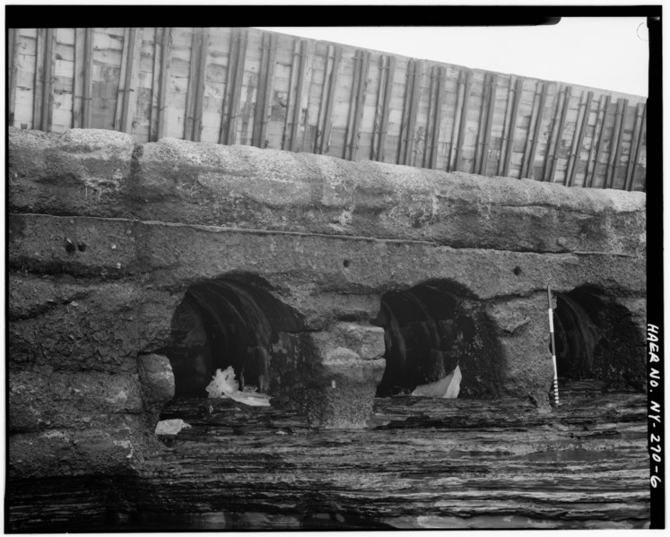 File:Southwest facing view of the Romanesque Arches. Horizontal line above the arches marks the 1923 raising of the dam. Flashboards cap the dam. - Glens Falls Dam, 100' to 450' West HAER NY,57-GLEFA,1-6.tif
